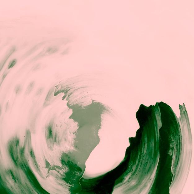Pinceladas de tinta verde sobre fundo de pêssego Foto gratuita