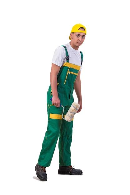Pintor de jovem reparador com rolo isolado no branco Foto Premium