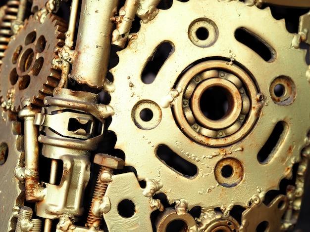 Pintura de óleo do ouro em um close up da máquina da parte. Foto Premium