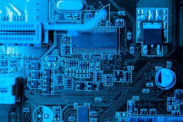 Placa de circuito no tema azul com slot Foto gratuita