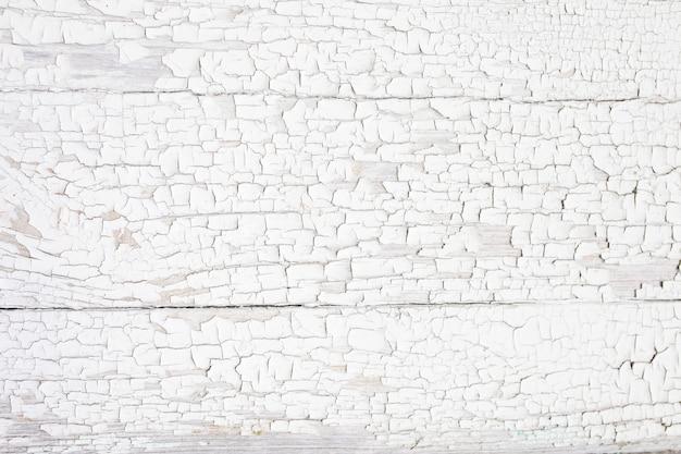 Placa de madeira de fundo com tinta rachada. branco - textura de madeira descascada Foto Premium