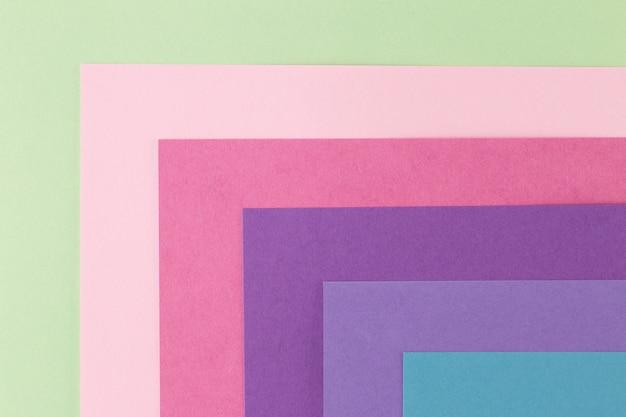 Plano de fundo multicolorido de um papel de cores diferentes, vista superior Foto Premium
