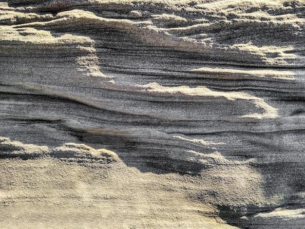 Plano de fundo texturizado de pedra em camadas. superfície rochosa Foto Premium