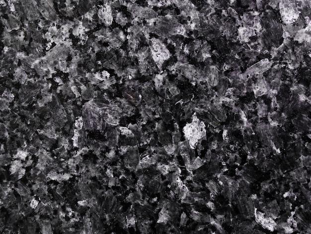 Plano de fundo texturizado escuro de pedra de granito Foto gratuita