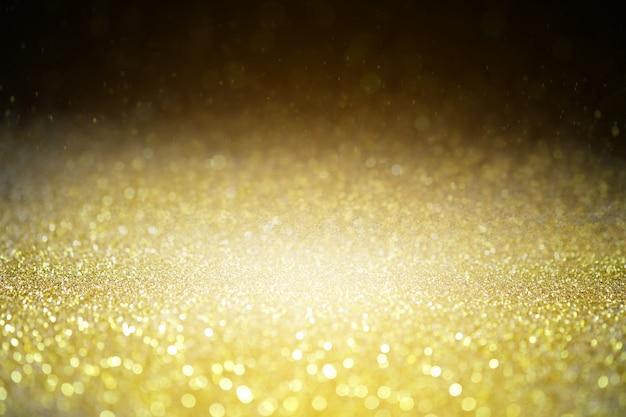 Plano de fundo texturizado glitter brilho ouro brilho luxo e valor. Foto Premium