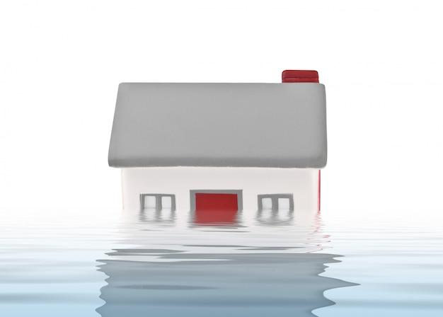 Plástico modelo da casa submergido sob a água Foto Premium