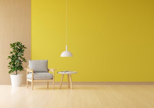 Poltrona cinza na sala de estar amarela com planta e mesa Foto Premium