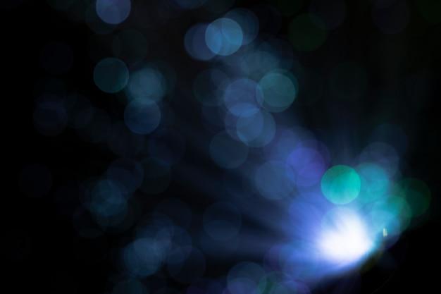 Pontos de luz brilhantes com cores frias Foto gratuita