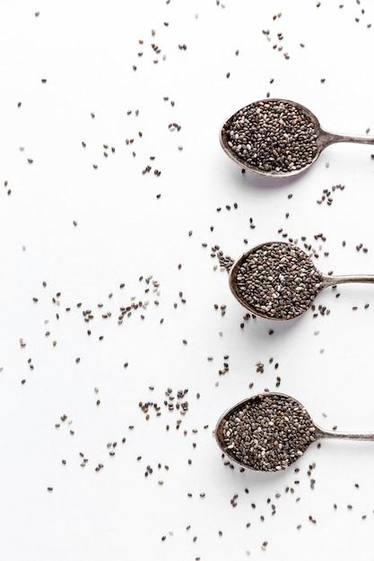 Postura plana do conceito de sementes de chia Foto Premium