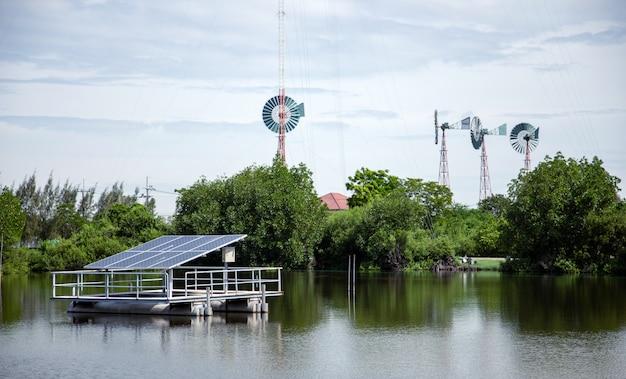Potência elétrica verde com célula solar e turbina eólica Foto Premium