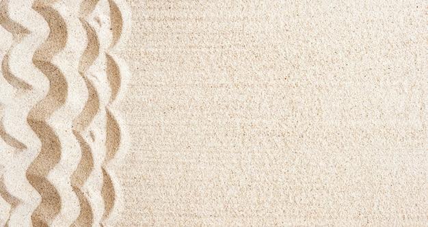 Praia de areia de textura para segundo plano. vista superior, cópia espaço, banner Foto Premium