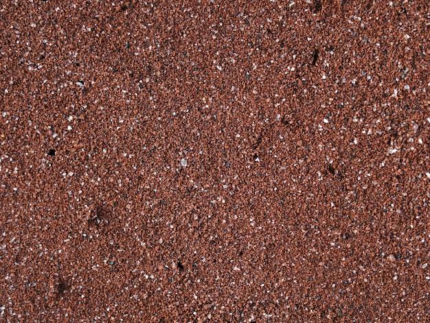 Praia de areia vermelha na ilha rubina no parque nacional de galápagos, equador Foto gratuita