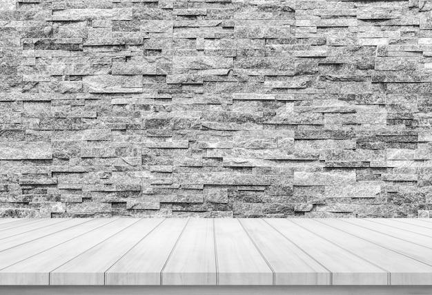 Prancha de madeira com fundo de parede de tijolo pedra abstrata para exposição do produto Foto Premium
