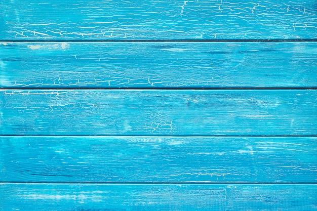 Pranchas de madeira rústicas azuis pintadas crackled fundo turquesa Foto Premium