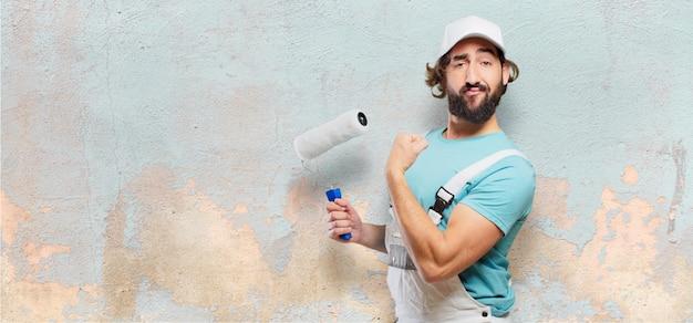 Profesional pintor pose forte Foto Premium