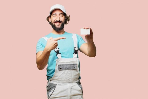 Profesional pintor segurando um cartão de visita Foto Premium