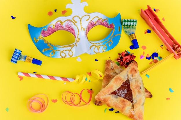 Purim com máscara de carnaval, fantasia de festa Foto Premium