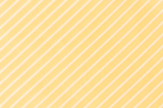 Quadro completo de linhas diagonais brancas sobre fundo amarelo Foto gratuita