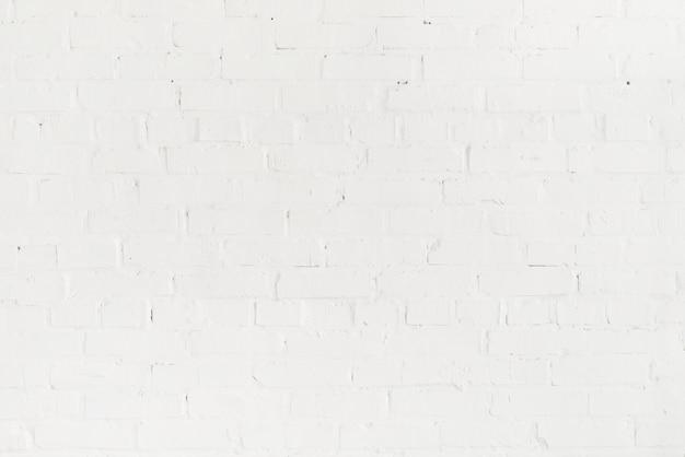 Quadro completo de parede branca de tijolo vazio em branco Foto gratuita