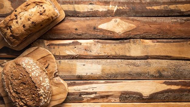 Quadro de comida plana leigos com pão assado Foto gratuita