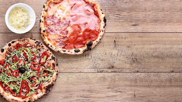Quadro de pizza plana leigos com cópia-espaço Foto gratuita
