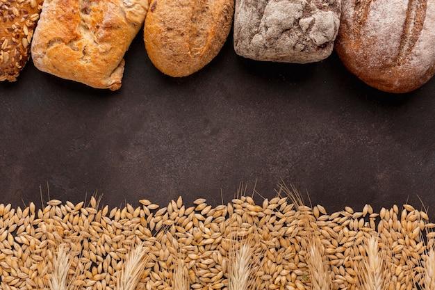 Quadro de sementes e pão de trigo Foto gratuita