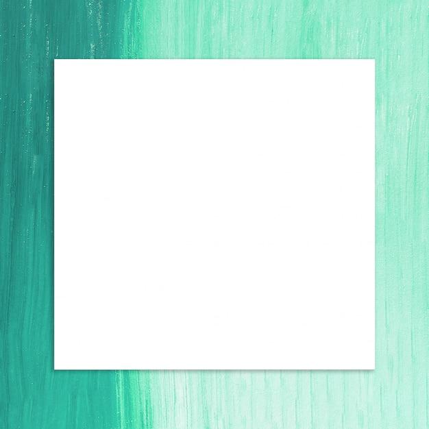 Quadro em branco com pincel de tinta verde fundo Foto gratuita