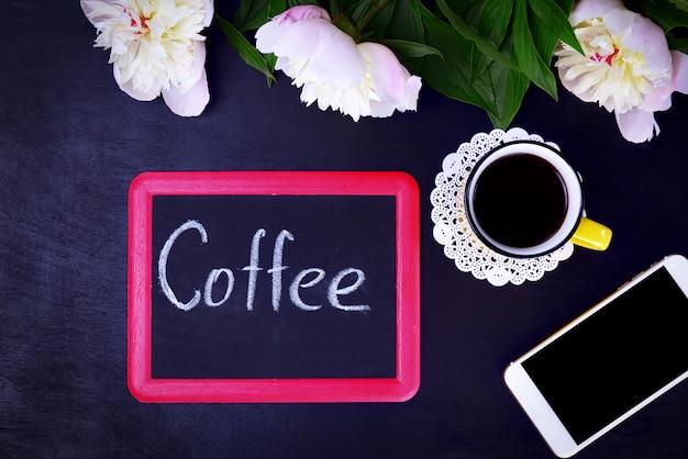 Quadro preto com uma inscrição de café Foto Premium