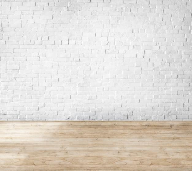 Quarto feito de parede de tijolos e piso de madeira Foto gratuita
