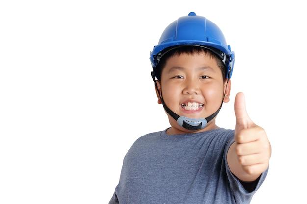 Rapaz asiático usa chapéus de segurança azuis com sorrisos e polegares para cima. Foto Premium
