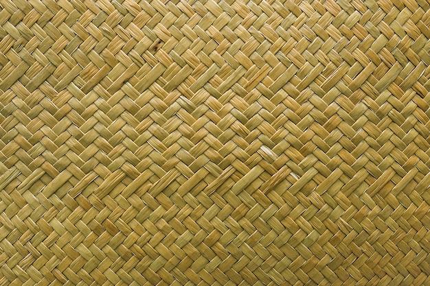 Rattan tecido trançado de vime natural, fundo da textura da grama do sedge Foto Premium