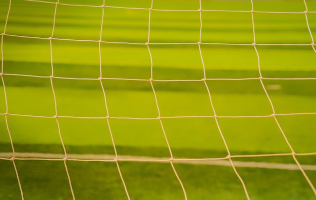 Rede de futebol. rede de futebol em fundo verde grama Foto Premium