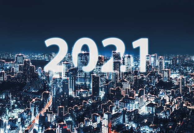 Rede inteligente e conceito de tecnologia de conexão, cidade digital de tóquio com fundo de texto de ano novo 2021 à noite no japão, vista panorâmica Foto Premium