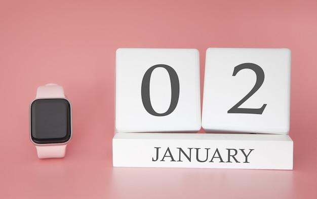 Relógio moderno com calendário de cubo e data 2 de janeiro em fundo rosa. conceito de férias de inverno. Foto Premium