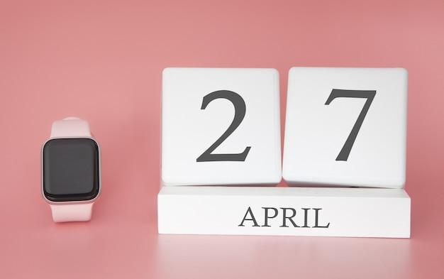 Relógio moderno com calendário de cubo e data 27 de abril em fundo rosa. férias de primavera conceito. Foto Premium