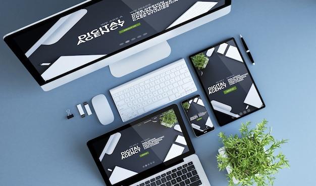 Renderização 3d da agência digital da vista superior dos dispositivos azuis Foto Premium
