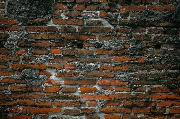 Reparo velho da parede de tijolo vermelho do vintage pelo cimento, fundo da textura da parede de tijolo da quebra Foto Premium