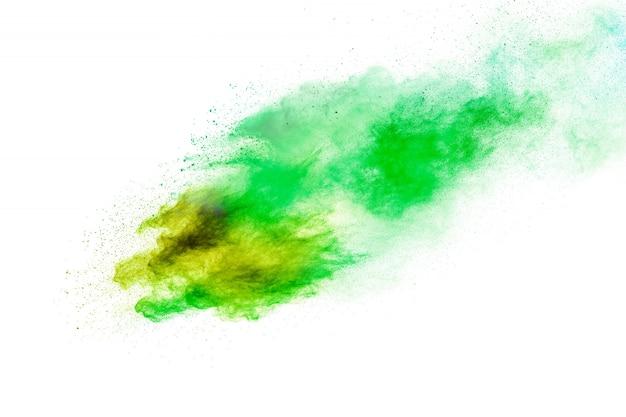 Respingo de poeira verde amarelo. nuvem amarela verde da explosão do pó da cor no fundo branco. Foto Premium