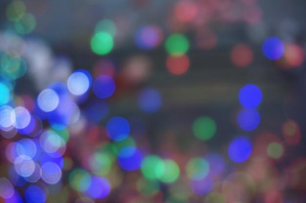 Resumo bokeh glitter vintage lights. natal bokeh luz defocused fundo abstrato. pode ser usado textura de papel de parede com área de espaço de cópia para um texto Foto Premium