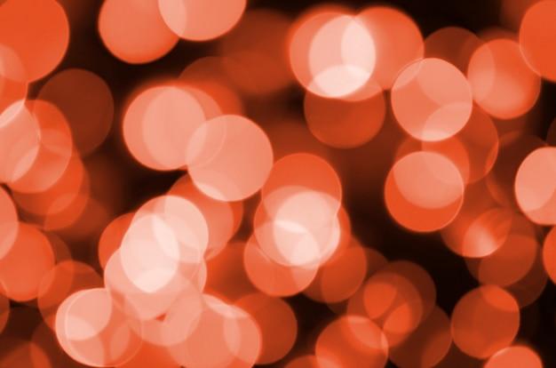 Resumo borrado de vermelho brilhante brilho lâmpadas luzes fundo Foto Premium