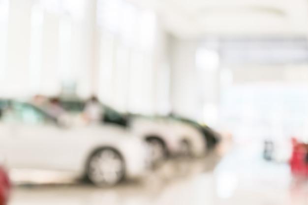Resumo borrão de carro no fundo da sala de exposições Foto Premium