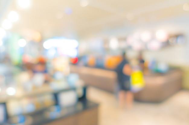 Resumo borrão pessoas no centro comercial Foto Premium