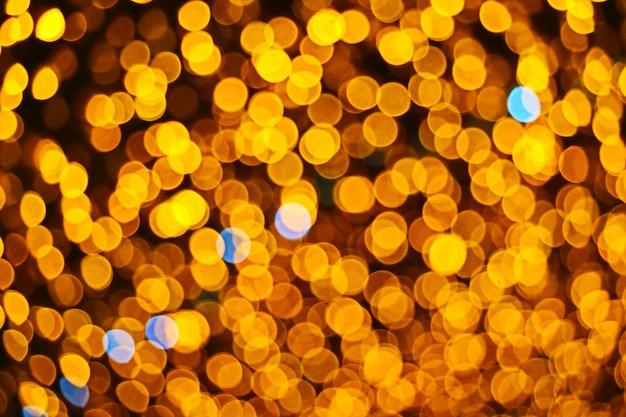 Resumo de cor laranja de borrão e bokeh colorido luz e noite jardim Foto Premium