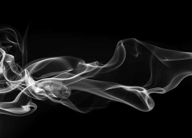 Resumo de fumaça branca sobre fundo preto, design de fogo Foto Premium