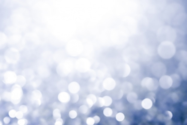 Resumo de textura de bokeh de natal luz brilhantes estrelas no bokeh. luzes do brilho do vintage Foto Premium
