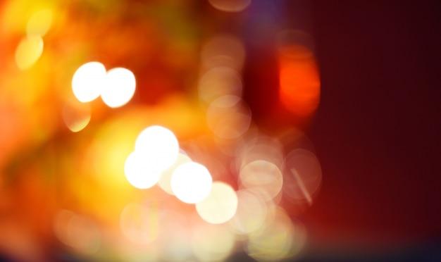 Resumo desfocar o fundo de bokeh com laranja e vermelho claro Foto Premium