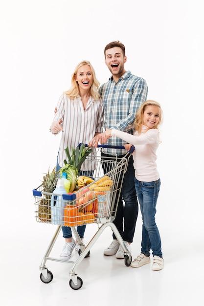Retrato de corpo inteiro de uma família alegre Foto gratuita