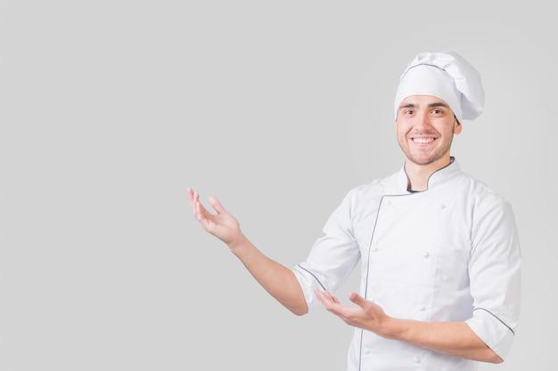 Retrato, de, cozinheiro chefe, apresentando, copyspace Foto gratuita