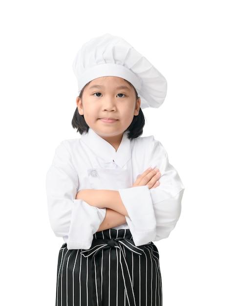 Retrato, de, cute, menina, cozinheiro, com, cozinheiro, chapéu, e, avental, levantar, e, sorrizo, isolado, branco, fundo Foto Premium
