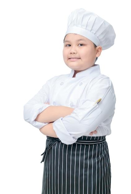Retrato, de, cute, menino, cozinheiro, com, cozinheiro, chapéu, e, avental, levantar, e, sorrizo, isolado, branco, fundo Foto Premium